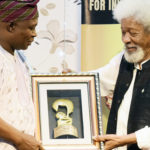 Adekunle Yusuf receiving is award from Prof Wole Soyinka