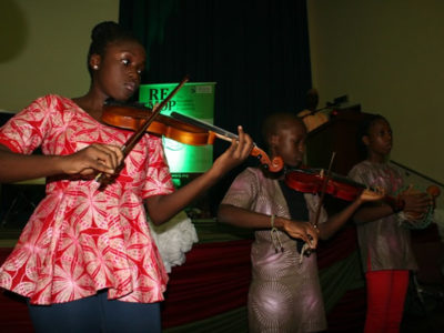 Julie Darling Children Orchestra, opening the 2017 Wole Soyinka Media Lecture Series event in Abuja with a rendition of the National Anthem